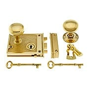Solid Brass Horizontal Rim Lock & Knobs In Unlacquered Brass (item #R-01DE-153-1022-UL)