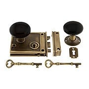 Antique Brass Horizontal Rim Lock Set With Black Porcelain Door Knobs (item #R-01DE-BLK-1022-AB)