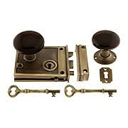 Antique Brass Horizontal Rim Lock Set With Brown Porcelain Door Knobs (item #R-01DE-BRN-1022-AB)