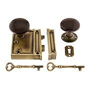 Antique Brass Vertical Rim Lock Set With Brown Porcelain Door Knobs (item #R-01DE-BRN-1022V-AB)