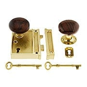 Polished Brass Vertical Rim Lock Set With Bennington Style Porcelain Knobs (item #R-01DE-SBN-1022V-PB)