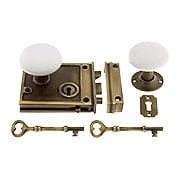 Antique Brass Horizontal Rim Lock Set With White Porcelain Knobs (item #R-01DE-WHT-1022-AB)
