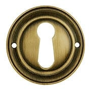 Round Stamped Brass Keyhole Cover in Antique-By-Hand Finish (item #R-08BM-1218-ABH)