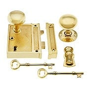 Solid Brass Vertical Rim Lock & Knobs In Unlacquered Brass (item #R-01DE-153-1022V-UL)