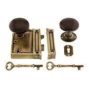 Antique Brass Vertical Rim Lock Set With Brown Porcelain Door Knobs (item #R-01DE-BRN-1022V-AB)