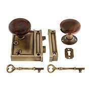 Antique Brass Vertical Rim Lock Set With Bennington Style Porcelain Knobs (item #R-01DE-SBN-1022V-AB)