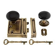 Solid Brass Vertical Rim Lock Set with Black Porcelain Door Knobs (item #R-01HH-1022V-BLKX)