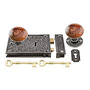 Cast Iron Scroll Rim Lock Set with Brown Swirl Porcelain Knobs (item #R-01HH-C1033-SBNX)