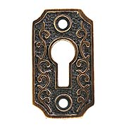 Solid-Brass Scroll Keyhole Cover in Antique-by-Hand (item #R-06DE-1033-SKH-ABH)