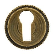Round Notched-Border Brass Keyhole Cover in Antique-by-Hand (item #R-08SE-0150001-ABH)
